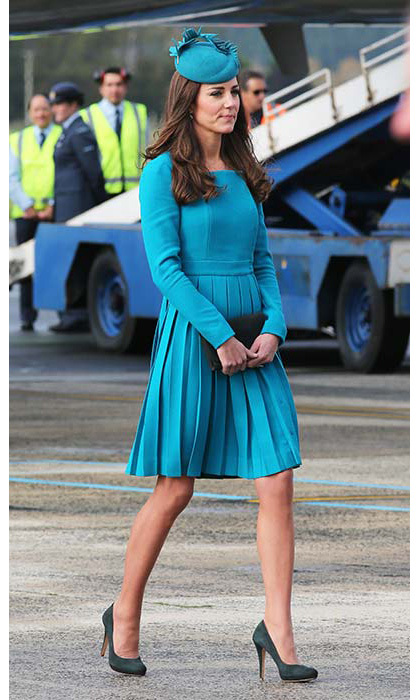 The duchess wore a bright aqua Emilia Wickstead dress when she touched down at Dunedin International Airport in New Zealand.