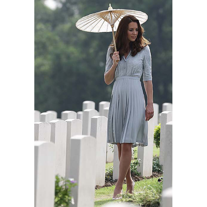 The duchess stuck with her favourite designers for a visit to the Kranji war memorial, choosing a Jenny Packham dress and L.K. Bennett heels. She added a nude parasol to protect her from the sun.