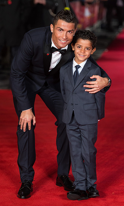 Soccer star Cristiano Ronaldo and his look-alike son make a fashionable pair on the red carpet at the world première of <em>Ronaldo</em> in London. 