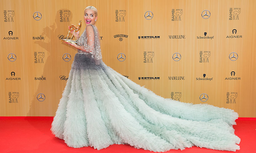 Turning heads in a pale-green tulle gown from Marchesa, singer Rita Ora shows off her International Music Award at the 2015 Bambi Awards in Berlin.
