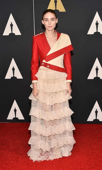 Rooney Mara walked the red carpet at the Governors Awards wearing an asymmetrical jacket and tiered skirt by Alexander McQueen. 