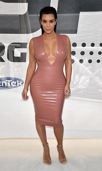 Showing off her world-famous curves in a pink latex dress.