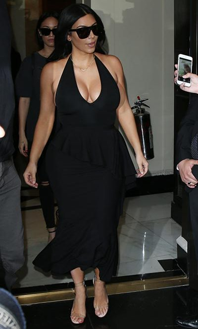 Wowing fans in a black dress with a plunging neckline.