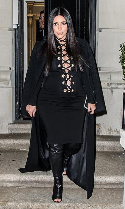 Channelling gothic chic in a black dress featuring lace-up detailing