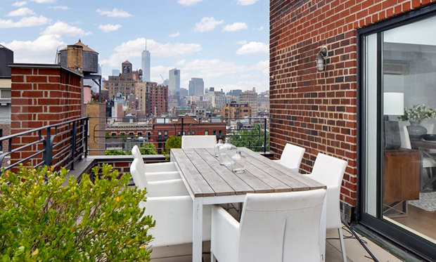 The terrace overlooks the New York skyline. 
