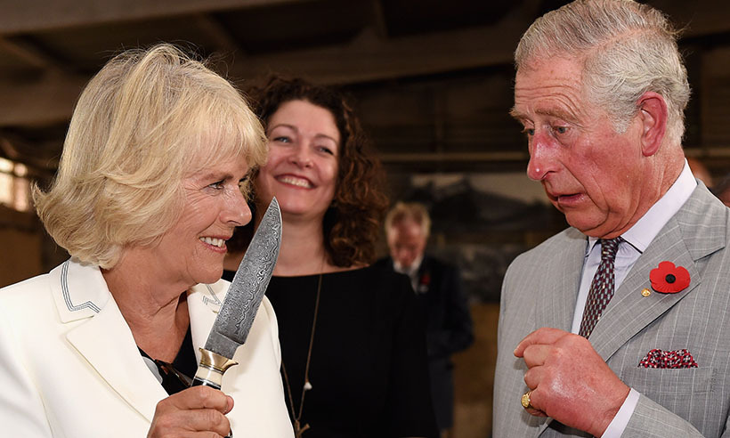 "A lovers' spat? No, just Prince Charles and Camilla having a little fun (as they often do!) on  Nov. 10 during their tour of Australia. This particular hand-crafted knife was brandished in Seppeltsfield, where the royals were visiting a winery and the Duchess of Cornwall joked that her prince ought to ""behave yourself!""