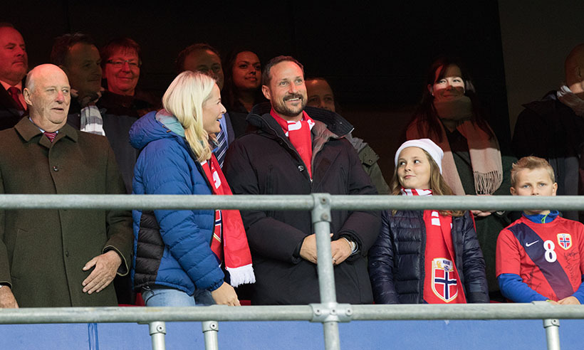 Norway's happy family, Princess Mette-Marit, King Harald V, Princess Ingrid Alexandra and Prince Sverre Magnus, took in a soccer match between Norway and Hungary in Oslo on Nov. 12 decked out in their team colours.