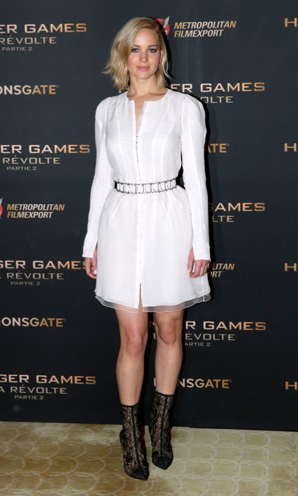 Jennifer Lawrence was white hot in Paris, rocking a belted white Dior dress and black lace boots. 