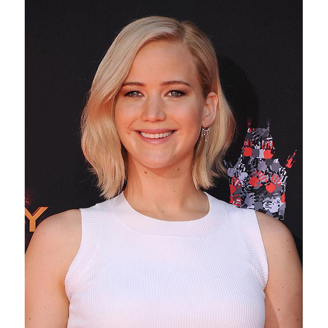 Debuting a new platinum bob as she joined <em>Hunger Games</em> co-stars Josh Hutcherson and Liam Hemsworth for a Hand and Footprint ceremony outside the Chinese Theatre in Los Angeles.