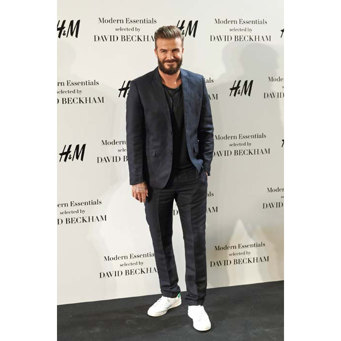 Adding a cool edge to his suit with Stan Smith trainers and a beard