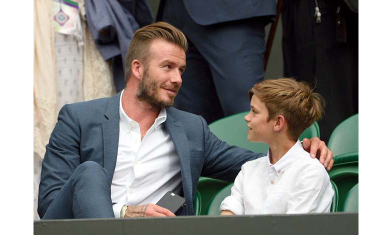 Forgoing a tie for another outing at Wimbledon with his son Romeo
