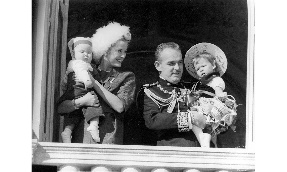 Baby Prince Albert and a young Princess Caroline are held by their parents on the palace balcony in November 1958.