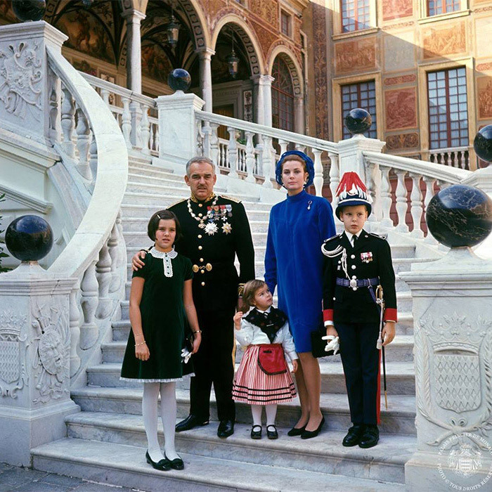 Prince Rainier, Princess Grace and their three children, Caroline, Stephanie and Albert, pose in the palace's main courtyard in 1967.<br>