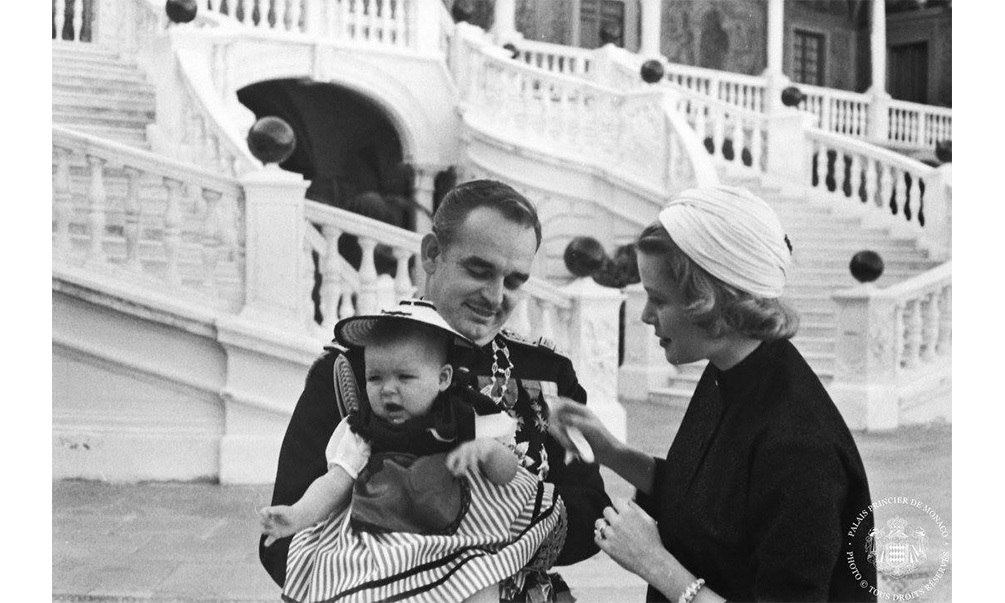 Prince Rainier holds his first-born, Princess Caroline, while his wife, Princess Grace, tends to their little bundle of joy.