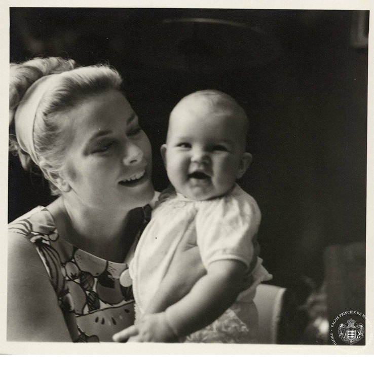 Princess Grace cradles her third and youngest child, Princess Stephanie.