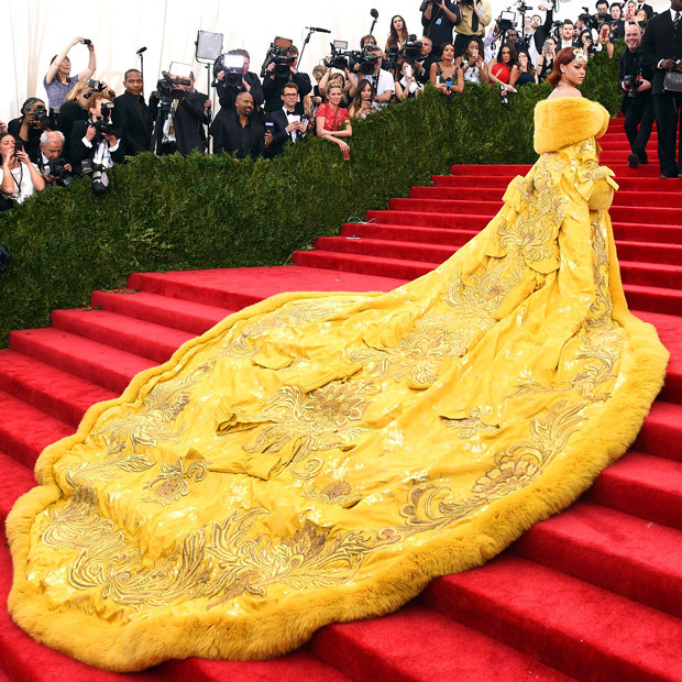 <p>Rhianna glows in a vibrant Guo Pei gown, complete with beautiful embroidery that exudes an Effie Trinket-like cheer and whimsy.</p>