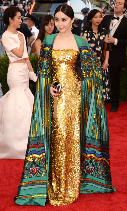 <p>Fan Bingbing would dazzle any well-heeled member of the Capitol in a gold Christopher Bu gown, complete with an oversized and intricately embroidered top coat.</p>