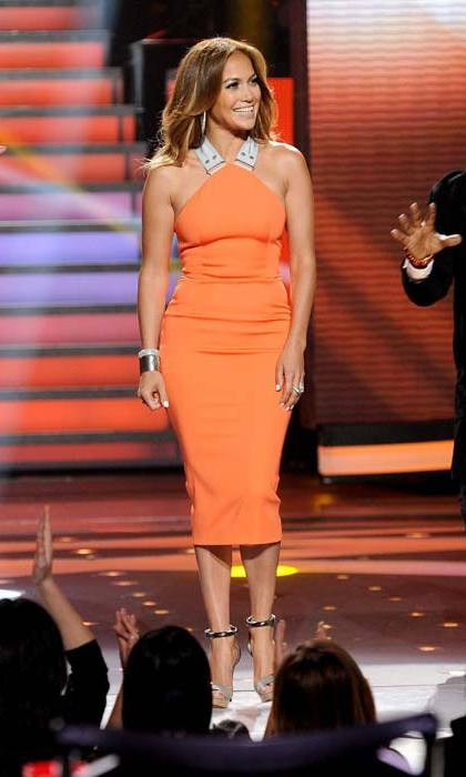 <strong>Jennifer Lopez</strong> shows off her curves in Victoria's utilitarian style tangerine dress in 2012.