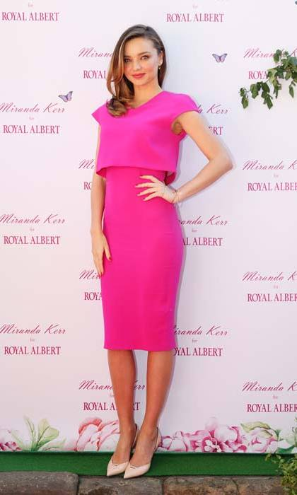 <strong>Miranda Kerr</strong> is pretty in pink in one of Victoria's most popular dresses.