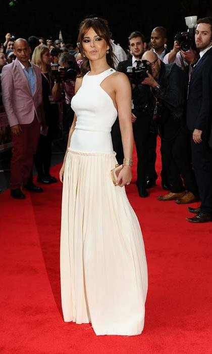 In 2012, Cheryl attended a movie opening in Victoria's white floor-sweeping gown.