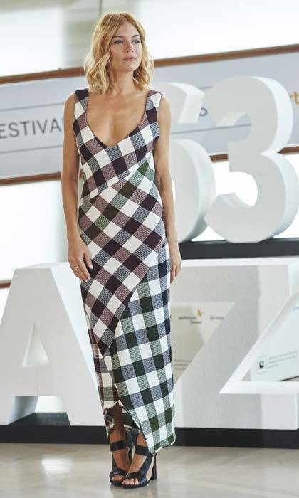 <strong>Sienna Miller</strong> wore Victoria's design to promote her film <em>High Rise</em> in September, and took this checked number straight off the catwalk.