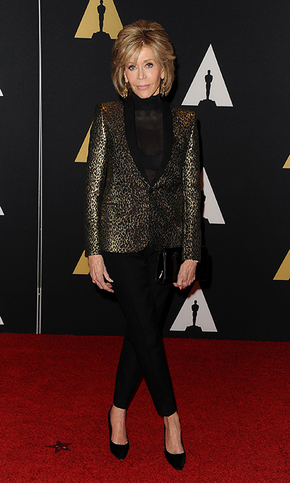 <p>Jane Fonda remains a style icon in this sleek pairing of cropped black trousers and sheer blouse with a gold metallic blazer at the American Academy of Motion Picture Arts and Sciences' Governors Awards in L.A.</p> 