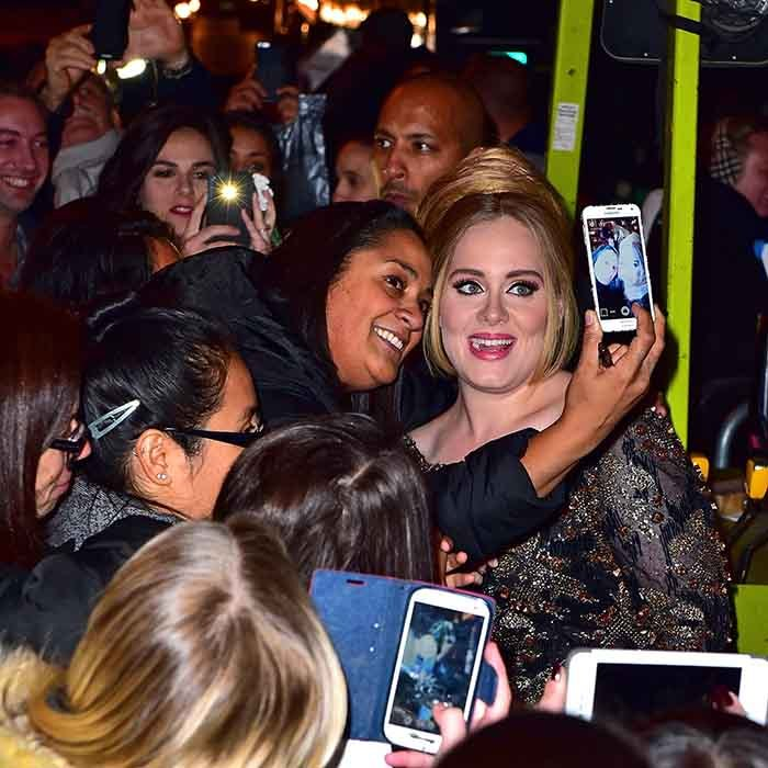 <p>On the eve of the release of her new album <em>25</em>, Adele takes time to greet some excited fans outside Radio City Music Hall in New York City. </p>