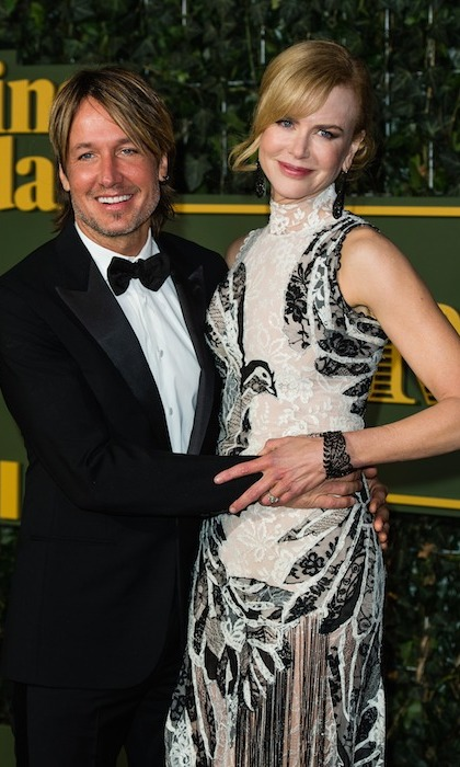 <p>Looking more in love than ever, Keith Urban embraced his Alexander McQueen-clad wife, Nicole Kidman, at the <i>Evening Standard</i> Theatre Awards in London.</p>