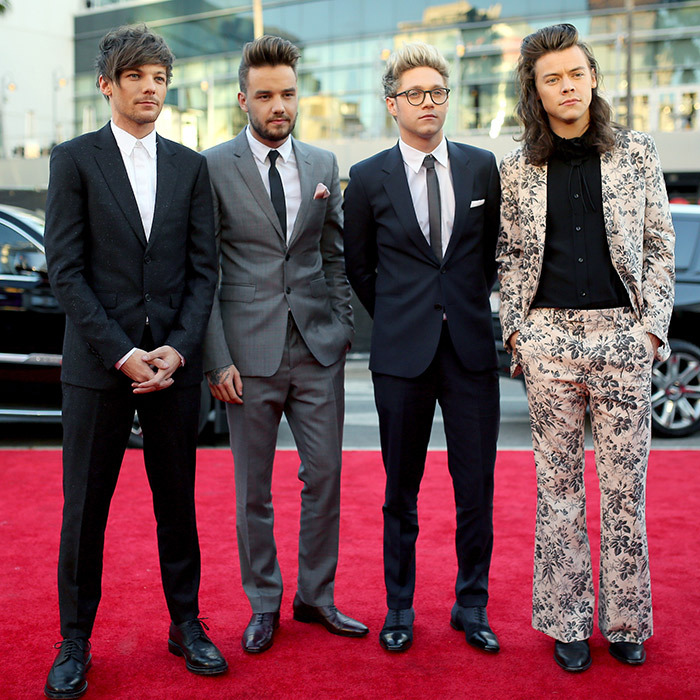 <p>One Direction: Louis Tomlinson in a Sandro suit with a Givenchy shirt and Grenson shoes. Liam Payne in a full Burberry look with Christian Louboutin shoes. Niall Horan in a Paul Smith look with Christian Louboutin shoes. Harry Styles in Gucci.</p>