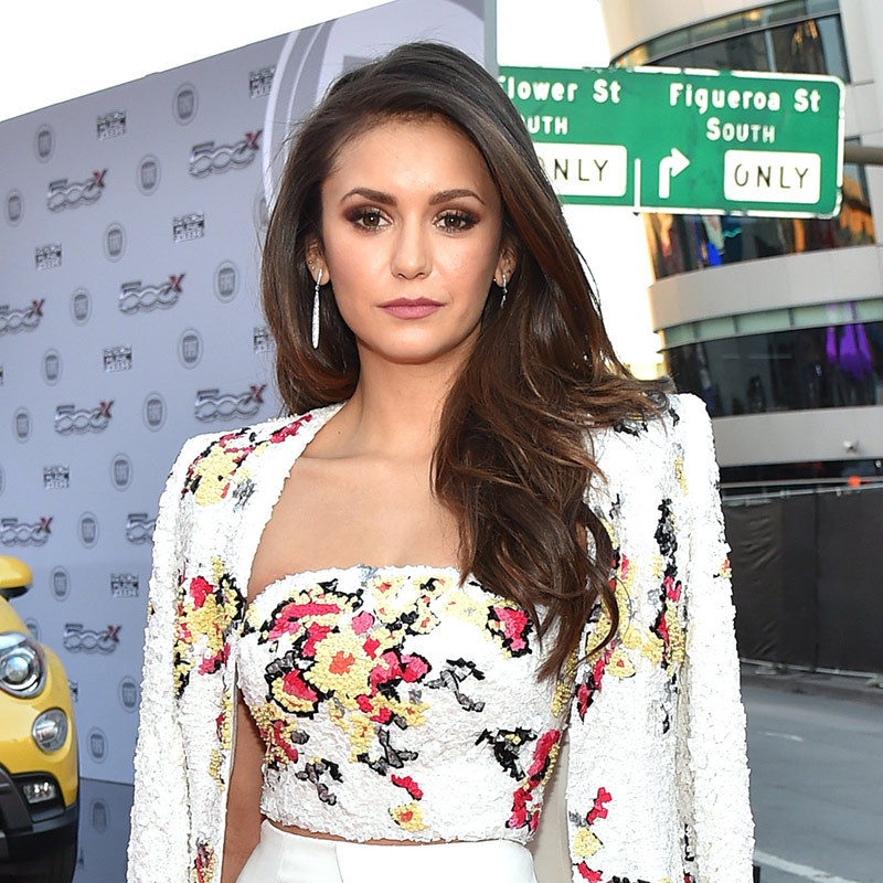 <p><b>Nina Dobrev</b> wore a rosy lip to go with her floral ensemble, paired with deeply side-parted blowout and brown smoky eye.</p> 