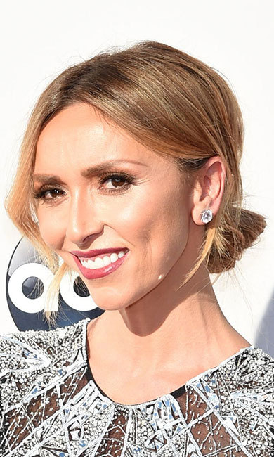 <p><b>Giuliana Rancic</b> was the epitome of old Hollywood glamour with an elegant chignon teamed with sparkling statement earrings and a slick of pink lipstick.</p>