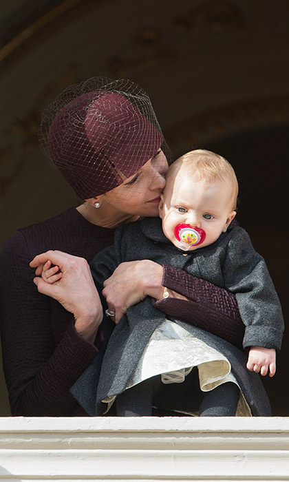 <p>Princess Gabriella got a kiss from her doting mom, Princess Charlene of Monaco, during her first National Day outing on Nov. 19.</p>