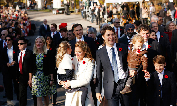 <p>Sophie, Justin and their three children walking to his swearing-in ceremony.</p>