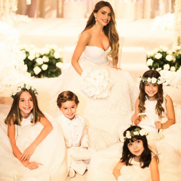 Sofia joined by her flower girls and page boy.