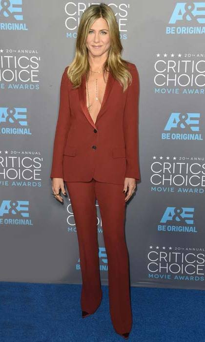 <p>Jennifer Aniston shunned her signature LBD look for a deep-red tuxedo.</p>