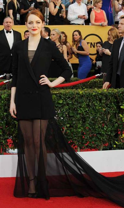 <p>Always one to buck a trend, Emma Stone turned her tuxedo into a dress.</p>