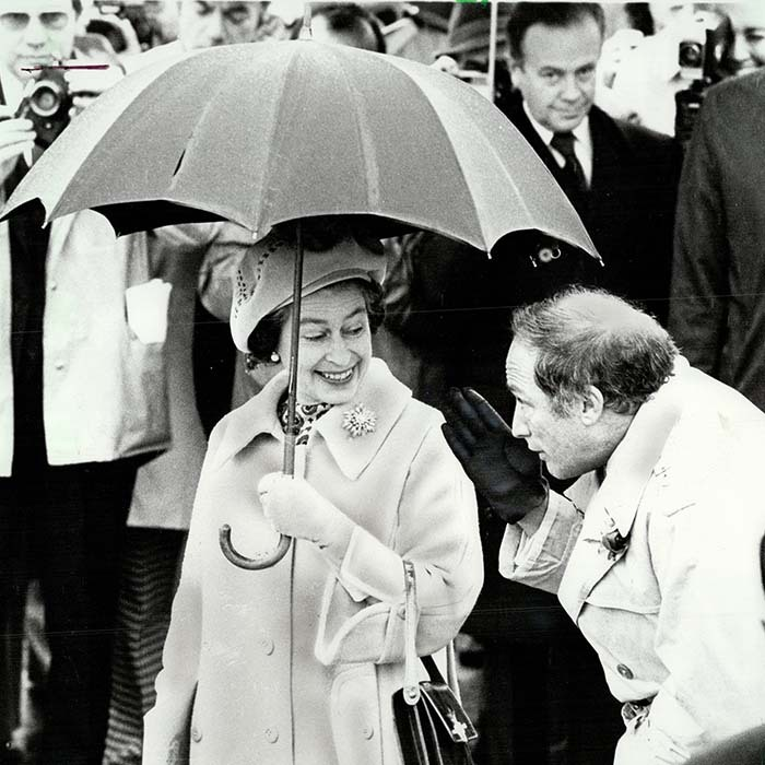 <p>The Canadian politician tried to take cover under Her Majesty's umbrella during a rainy public outing on Parliament Hill in 1977.</p>