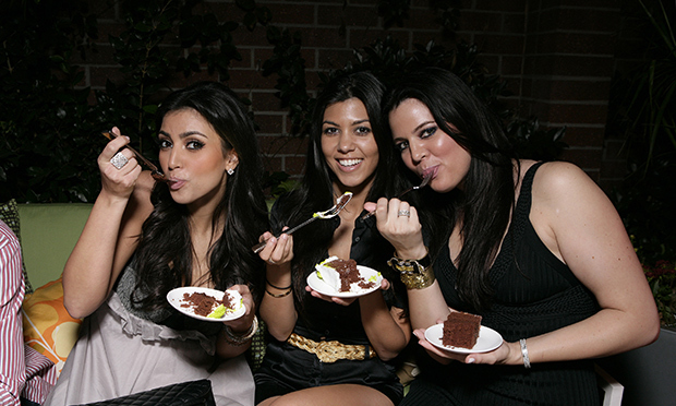 <p>Sisters who eat cake together, stick together! Kim, Kourtney and Khloe love a slice on special occasions. When Kim married Kanye West in 2014, she cut into a seven-tier layered fruit creation by Florence-based catering company Galateo.</p>   