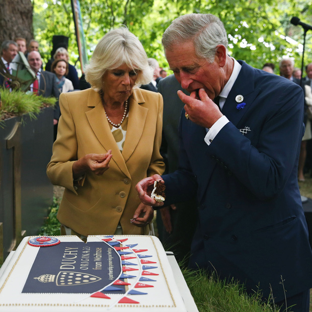 <p>The Duke and Duchess of Cornwall were treated to an enormous sheet cake at the 21st anniversary of Prince Charles's Duchy Originals line of products. </p> 