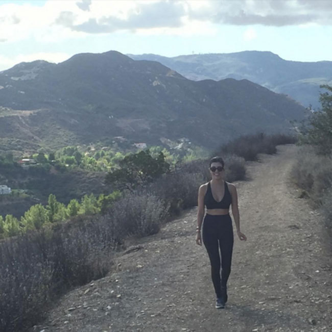 Kourtney Kardashian is often spotted going for hikes to stay in shape – and with studies showing that just 20 minutes a day can make a real difference to long-term health, it makes for a great workout. (@kourtneykardash)