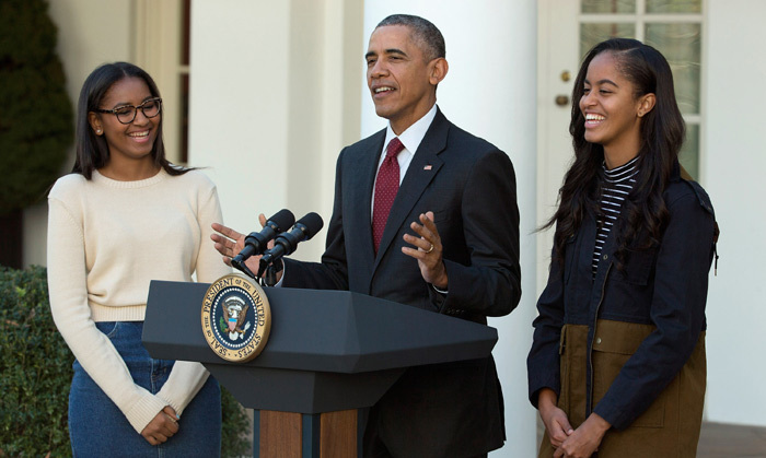 For the traditional turkey pardon, President Obama was joined by his daughters Sasha and Malia, who cracked up as dad told some Thanksgiving-themed jokes. On a more serious note, saved from being gobbled up on the White House dinner table were turkeys 'Honest' and 'Abe'.