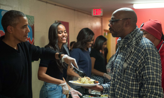 The Obama family was all smiles as they served up Thanksgiving dinner at homeless shelter Friendship Place in Washington, DC.