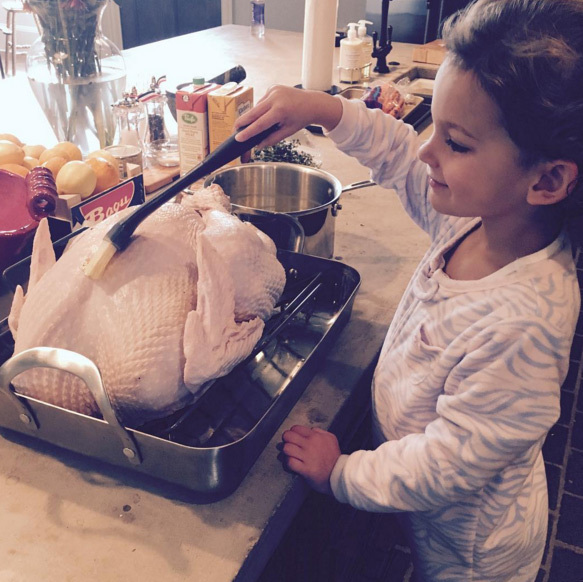 "Lily Aldridge had some help in the kitchen this year. ""Mommy's Little Helper ❤️旅❤️ Wishing everybody a Blessed & Happy Thanksgiving""