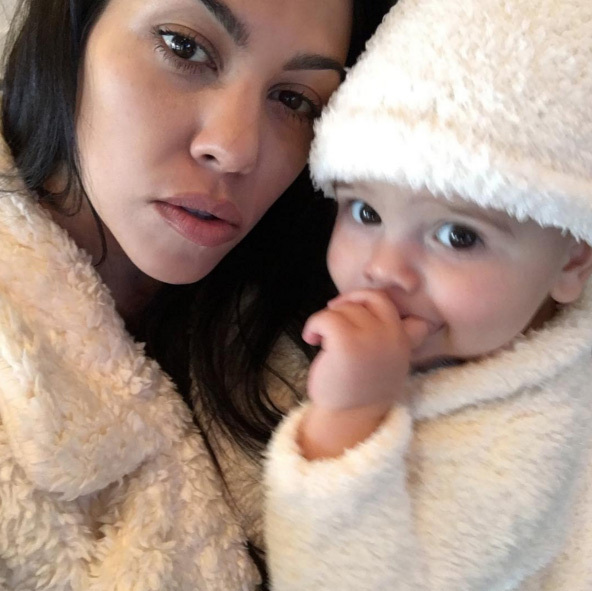 "Kourtney Kardashian shared this cute pic of her and Reign, writing: ""First Thanksgiving. #blessed""