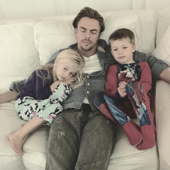 "Cuddled up with the kids, Derek Hough found all the excitement just too much to bear... ""Watching a movie but Uncle D is knackered. #thanksgiving.""