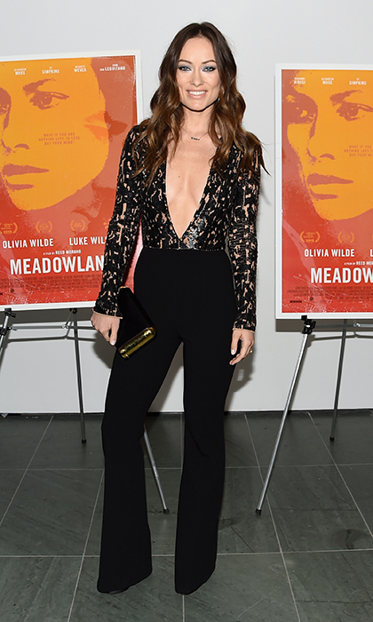 Gorgeous mom Olivia Wilde donned a sleek, plunging Michael Kors jumpsuit with plunging neckline to the <em>Meadowland</em> screening in New York. 