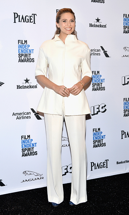 Elizabeth Olsen is sophisticated in this structured, creamy white pantsuit worn to the 2016 Film Independent Spirit Awards press conference in Hollywood. 