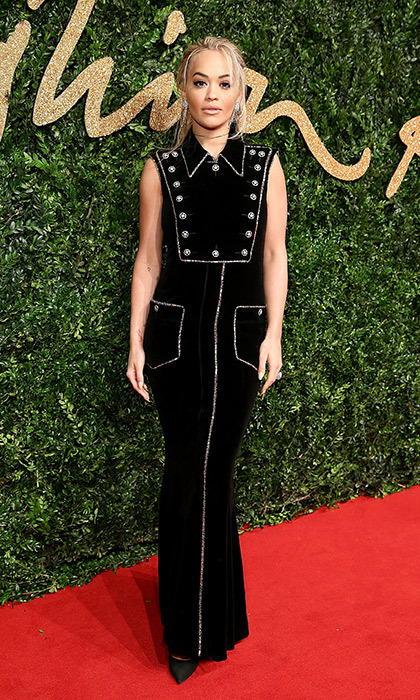 Rita Ora's stunning stunning Chanel column dress with suit detailing was an eye-catching menswear-inspired look at the 2015 British Fashion Awards in London. 