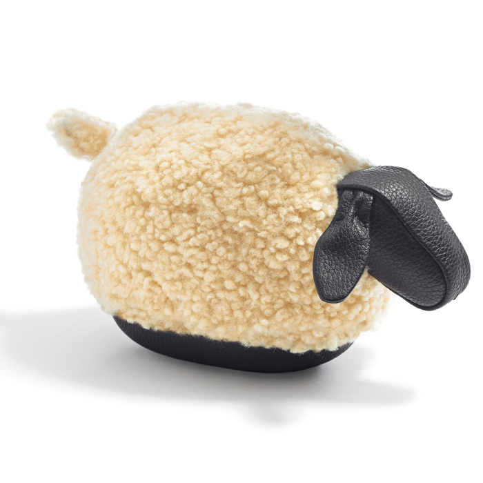 "Coach Shearling Lamb Paperweight, $110, <a href=""http://www.coach.com/coach-mens-accessories-shearling-sheep-paperweight/64775.html"">coach.com</a>."