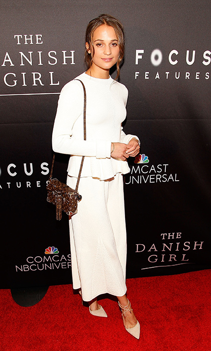 Alicia Vikander is a lovely vision in a matching white Victoria Beckham top and culottes paired with nude Aquazurra heels. The Louis Vuitton leopard bag lends the neutral look, worn to the Washington premi&egrave;re of <em>The Danish Girl,</em> a playful vibe. 